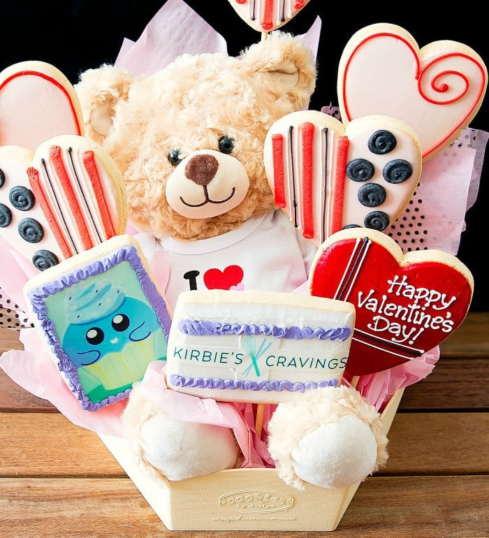 photo of a cookie bouquet with a teddy bear