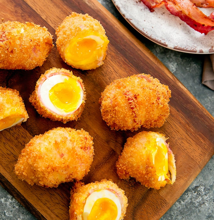 overhead photo of fried bacon wrapped eggs