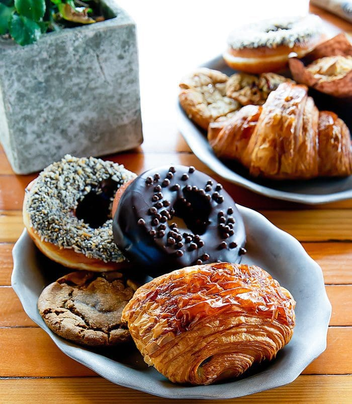photo of a plate of pastries and doughnuts Herb & Eatery