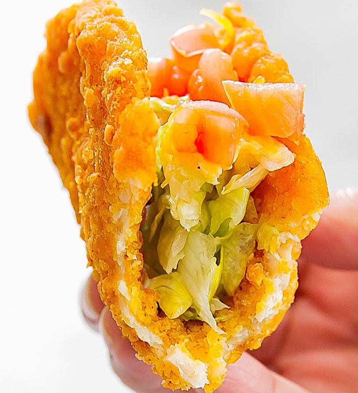 close-up of the Naked Chicken Chalupa with a bite taken out of it
