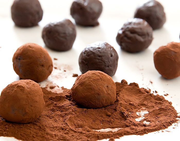 photo showing how to roll the balls in the cocoa powder