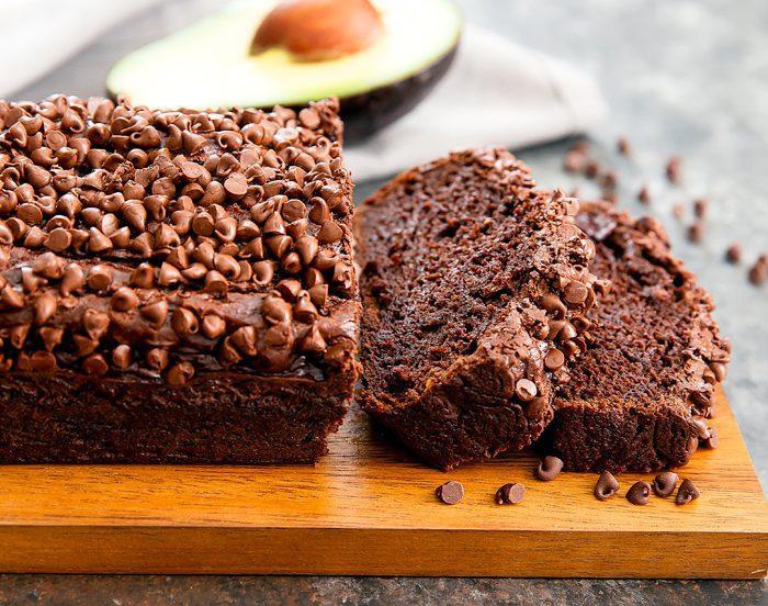 side-view photo of sliced chocolate avocado banana bread