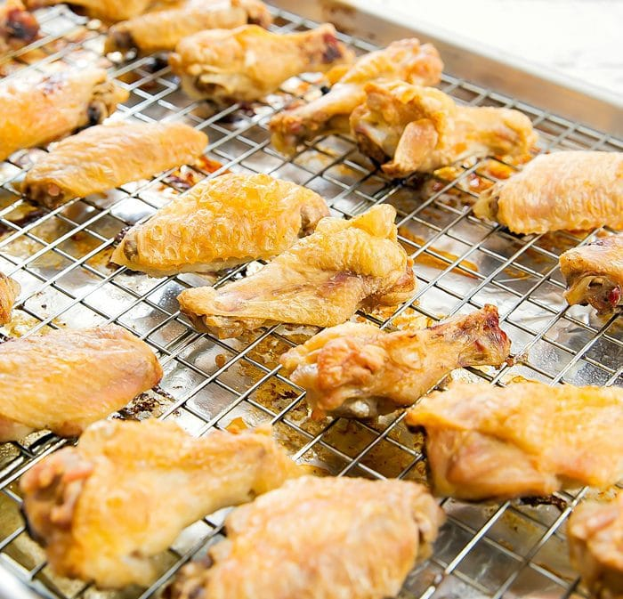 baked chicken wings on a sheet pan fitted with a baking rack