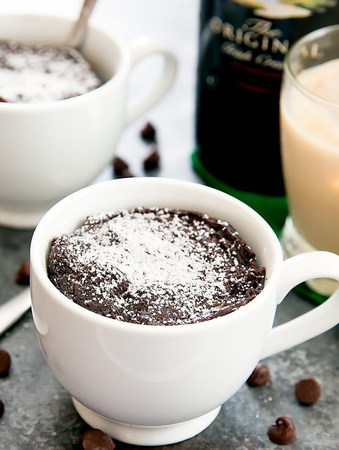 Flourless Baileys Chocolate Mug Cake dusted with powdered sugar