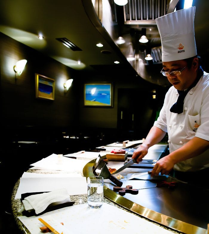 photo of a cook preparing food teppanyaki-style