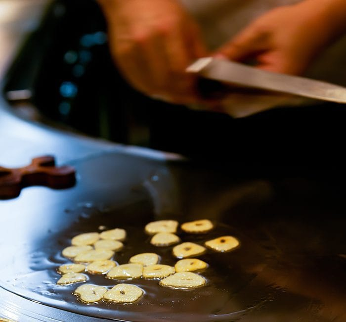 photo of garlic cooking on a griddle