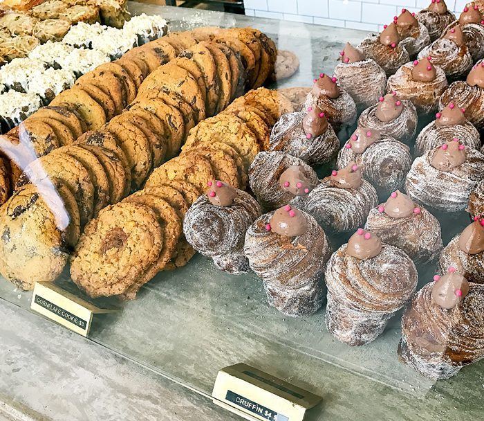 photo of cruffins and cookies in a display case
