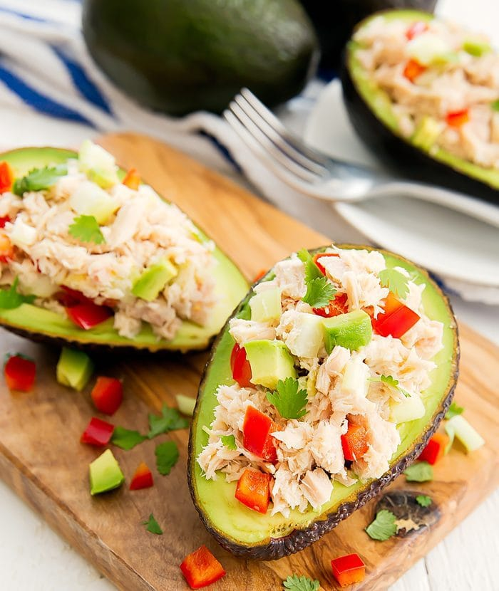 two Tuna Salad Avocado Boats on a cutting board