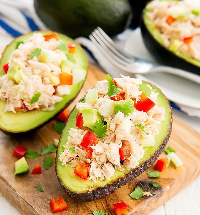 photo of avocado halves stuffed with tuna salad