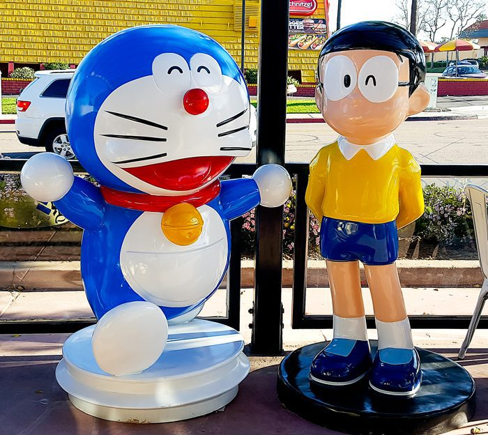photo of two other character statues