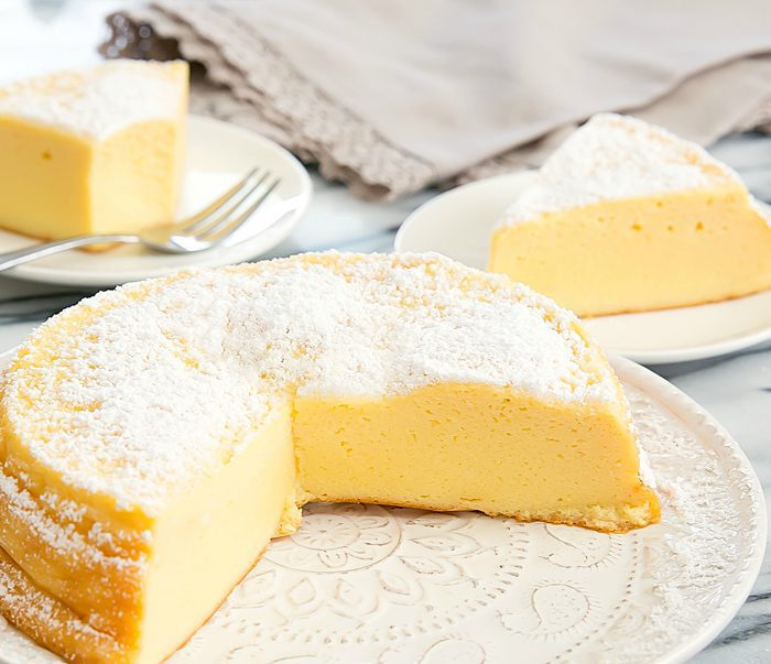 photo of a Japanese cheesecake with two slices removed