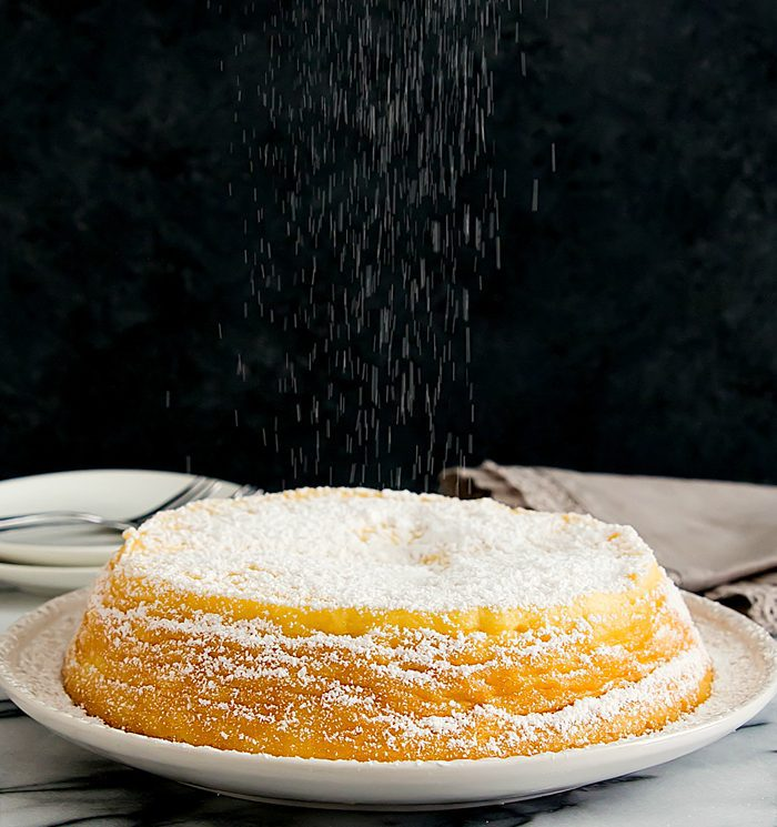 photo of powdered sugar being showered over a Japanese cheesecake