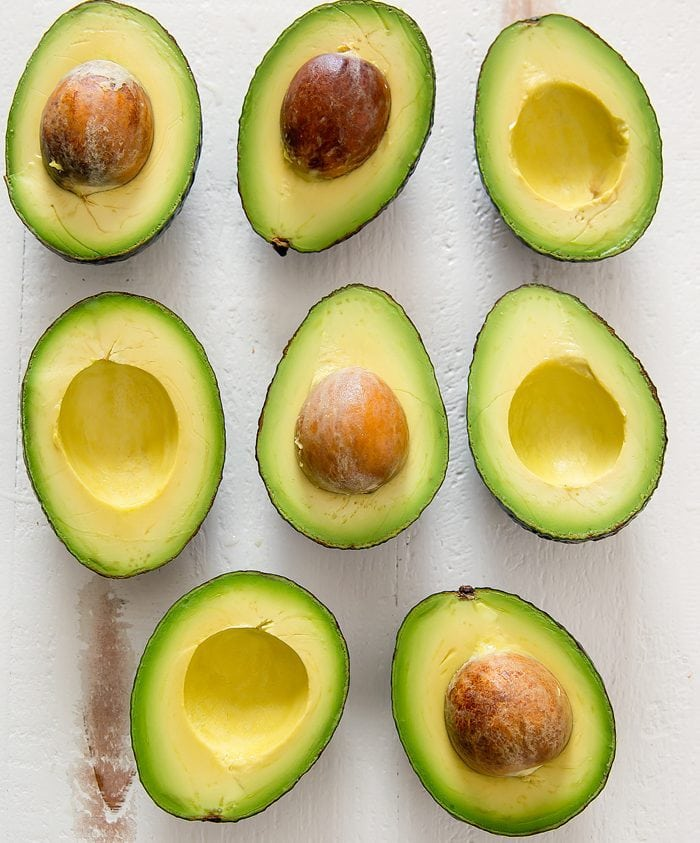 overhead photo of avocado halves