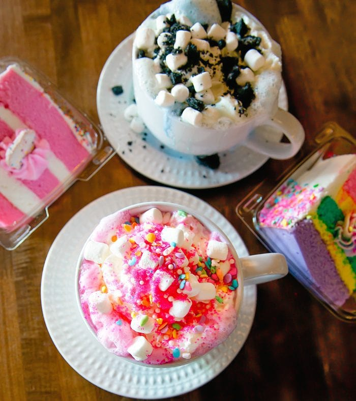 overhead photo of Unicorn Hot Chocolate, Cookie Monster Hot Chocolate, Unicorn Cake, and Pink Velvet Cake