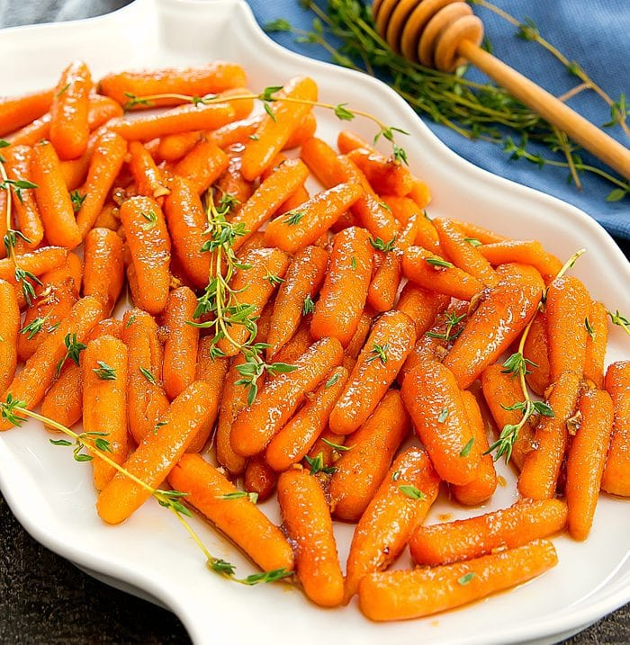 a close-up photo of honey-garlic roasted carrots