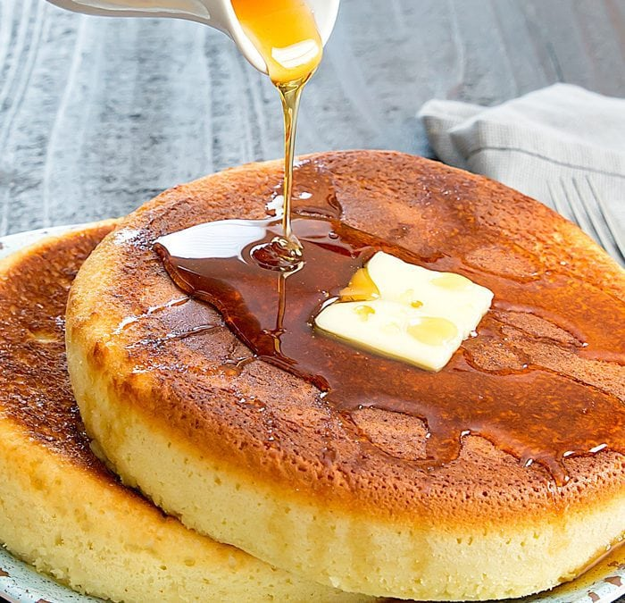 photo of syrup being poured over a pancake