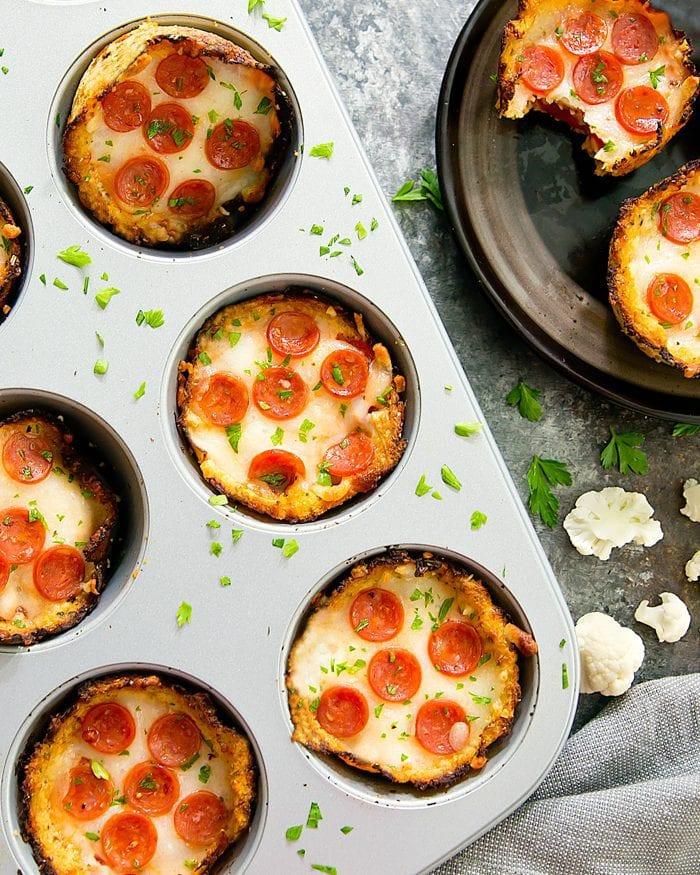 overhead photo of Mini Cauliflower Deep Dish Pizzas in a muffin tin