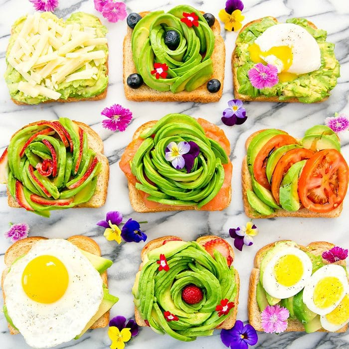 an top-down photo of nine different avocado toasts
