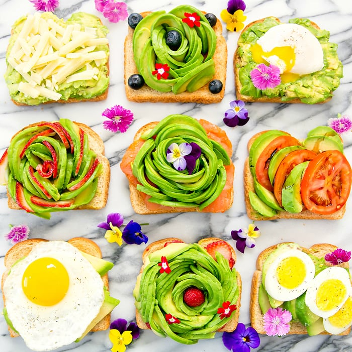 overhead photo of different kinds of avocado toasts