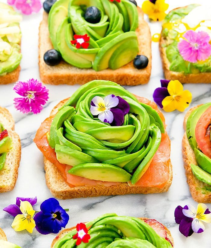 toast with and avocado rose on top