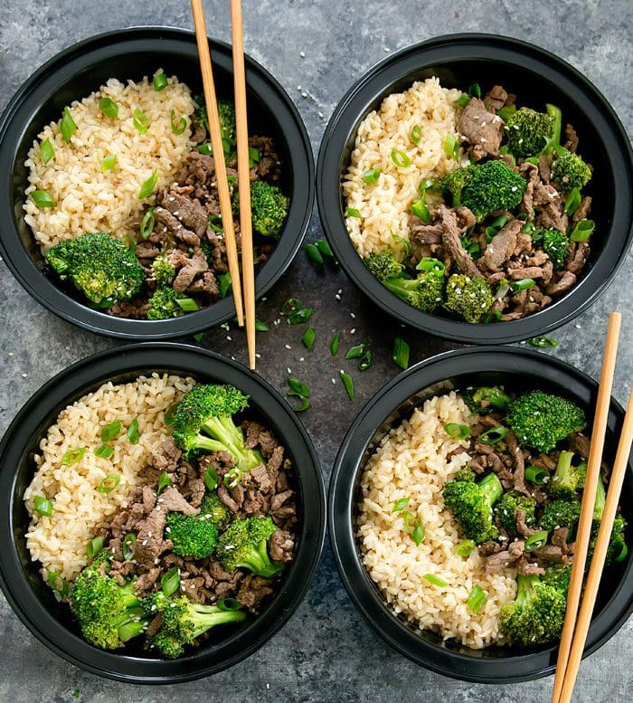 overhead photo of four Korean Beef Bowls with chopsticks