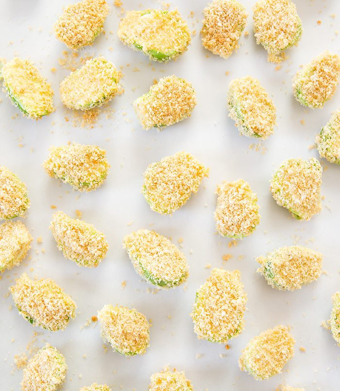 overhead prep shot of sliced raw brussels sprouts coated in breadcrumbs