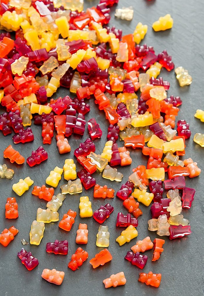 Vegan Fruit Snack Gummies scattered on a board