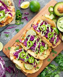 overhead photo of fish tacos with avocado sauce