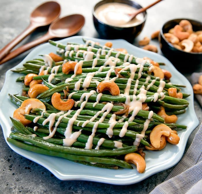 Girl & The Goat Sautéed Green Beans topped with aioli and cashews