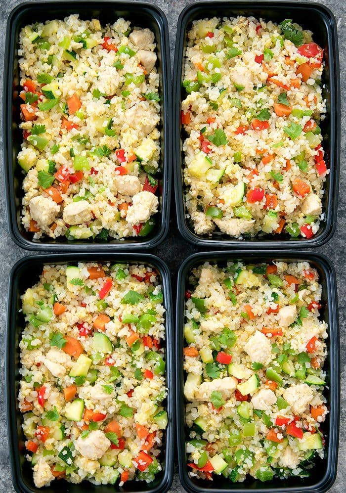 top-down photo of chicken cauliflower fried rice in four meal prep containers