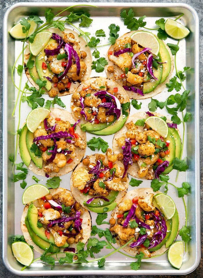 overhead photo of cauliflower tacos on a sheet pan