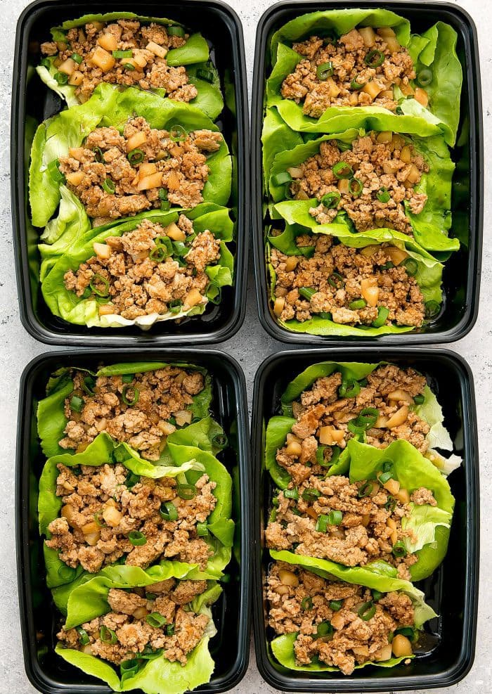 overhead photo of four containers of Chicken Lettuce Wraps