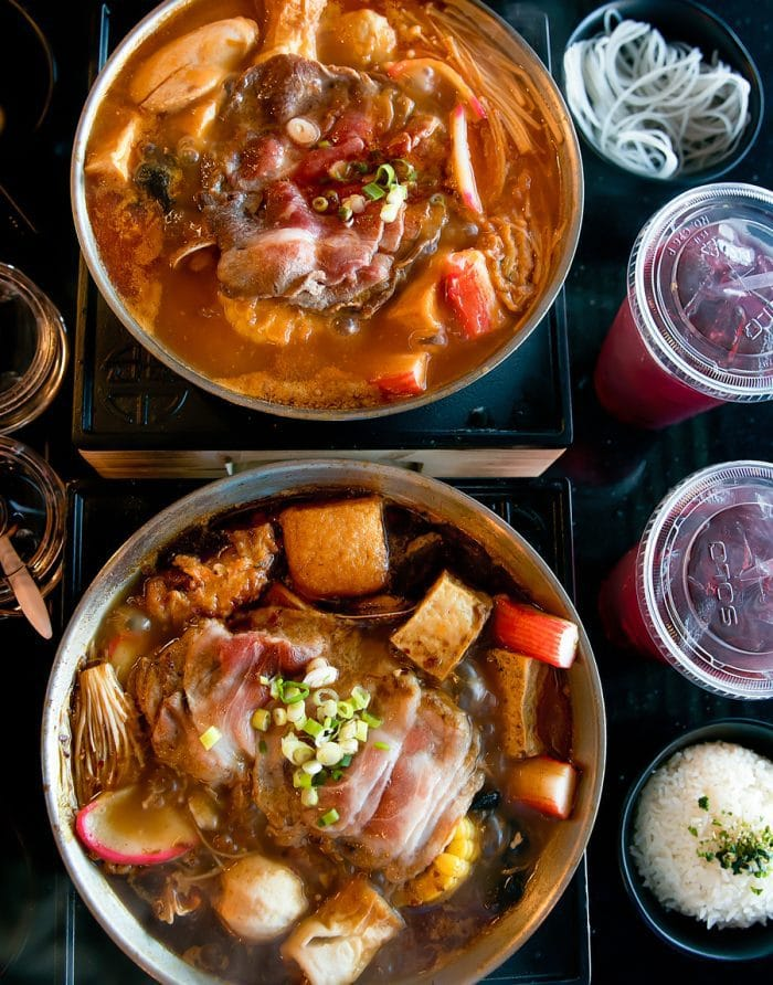 overhead photo of two hot pots served at Uniboil