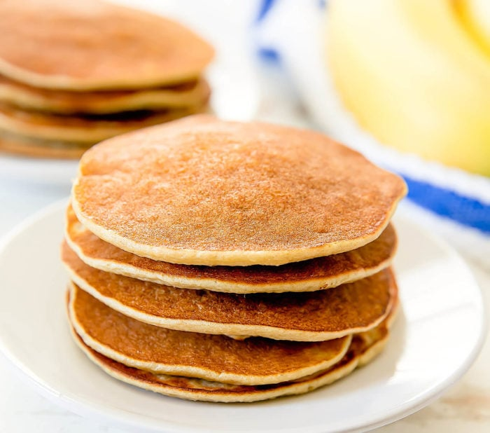 a stack of flourless banana pancakes on a white plate