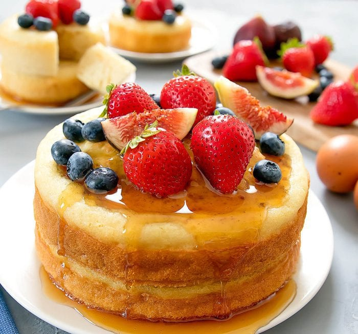 photo of Baked Buttermilk Pancakes garnished with syrup and fresh fruit