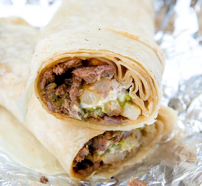 close-up photo of the california burrito sliced in half to show the inside
