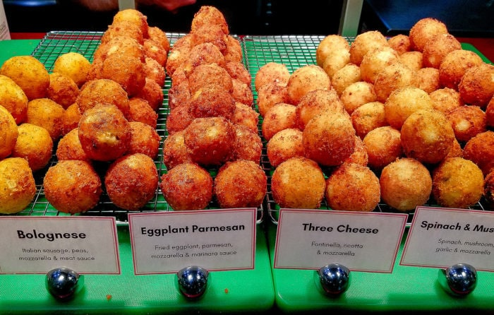 photo of different kinds of arrancini at Roma Express