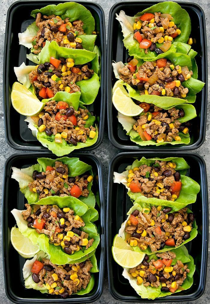 overhead photo of Taco Lettuce Wraps in four meal prep containers