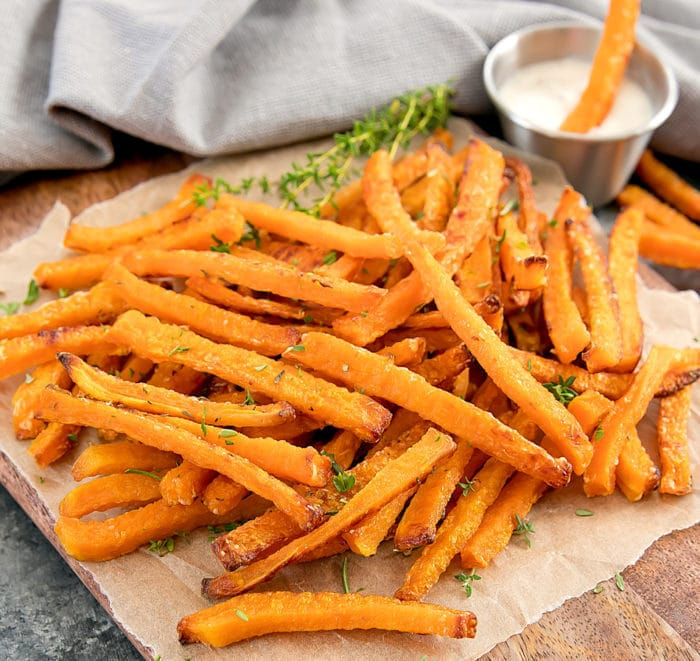 Butternut Squash Fries on parchment paper