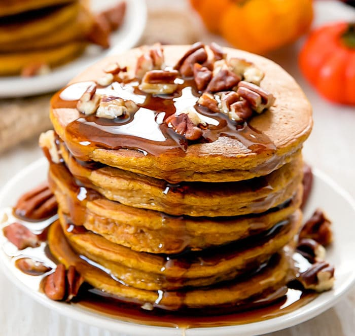 a close-up photo of a stack of flourless pumpkin pancakes