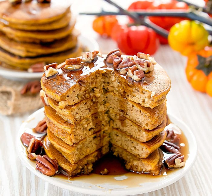 a stack of flourless pumpkin pancakes with a piece cut out