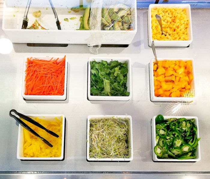 photo of topping options for poke bowls