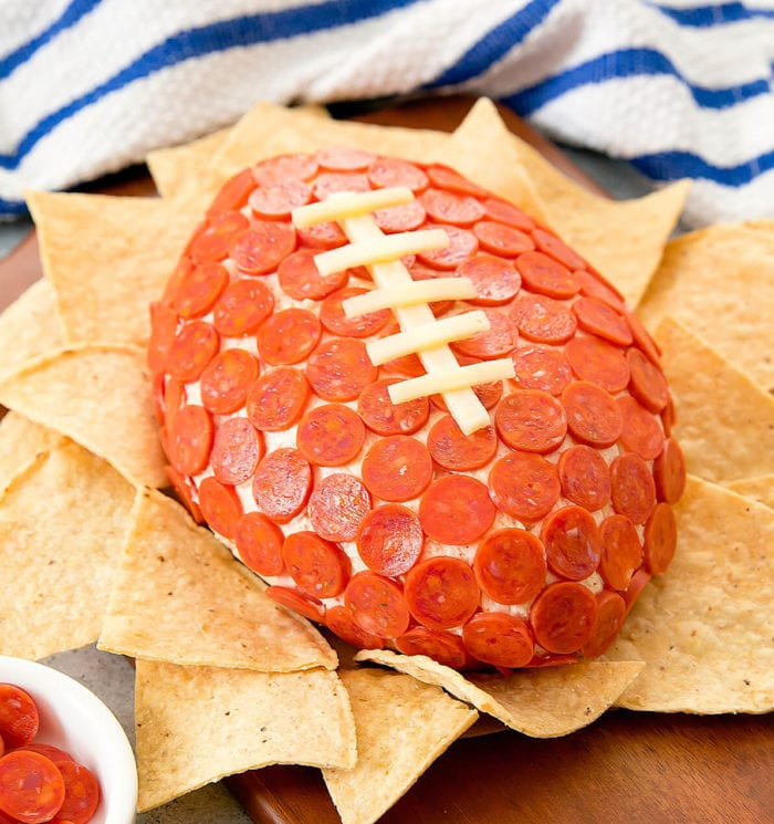close-up photo of Pepperoni Pizza Cheese Ball with tortilla chips around it