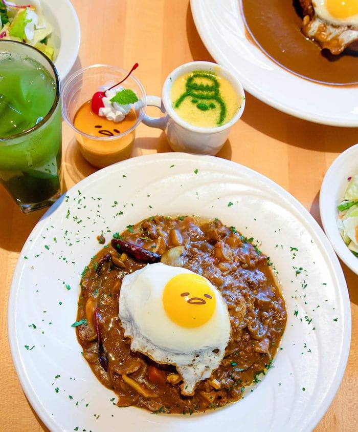 overhead photo of an egg dish Gudetama x Curry House
