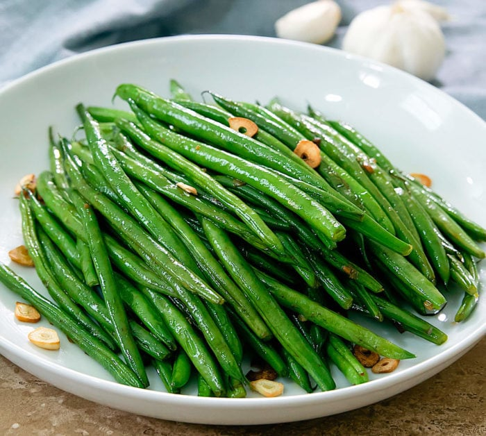 photo of Garlic Green Beans on a white plate