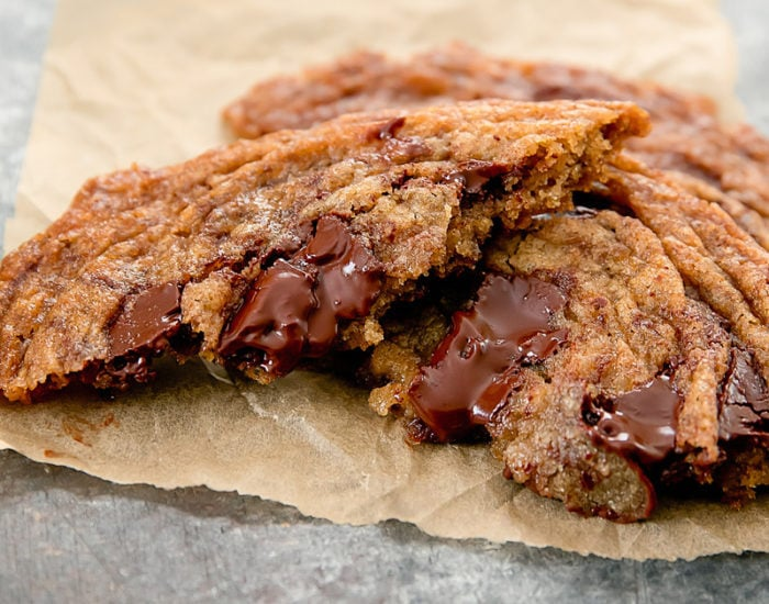 close-up photo of a chocolate chip cookie with chocolate oozing out