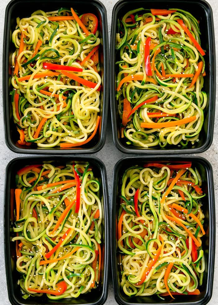 overhead photo of four meal prep containers with Zucchini Noodles Chow Mein