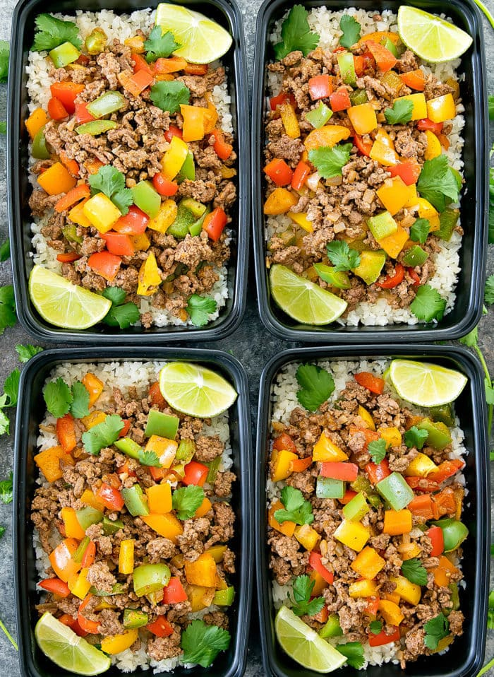 overhead photo of Fajita Bowls with Cauliflower Rice in meal prep containers