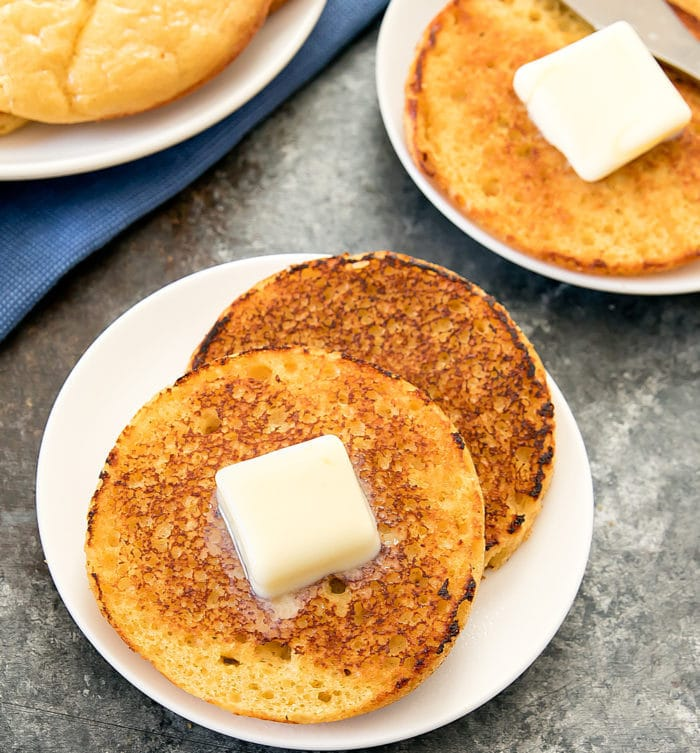 overhead photo of sliced english muffin with butter