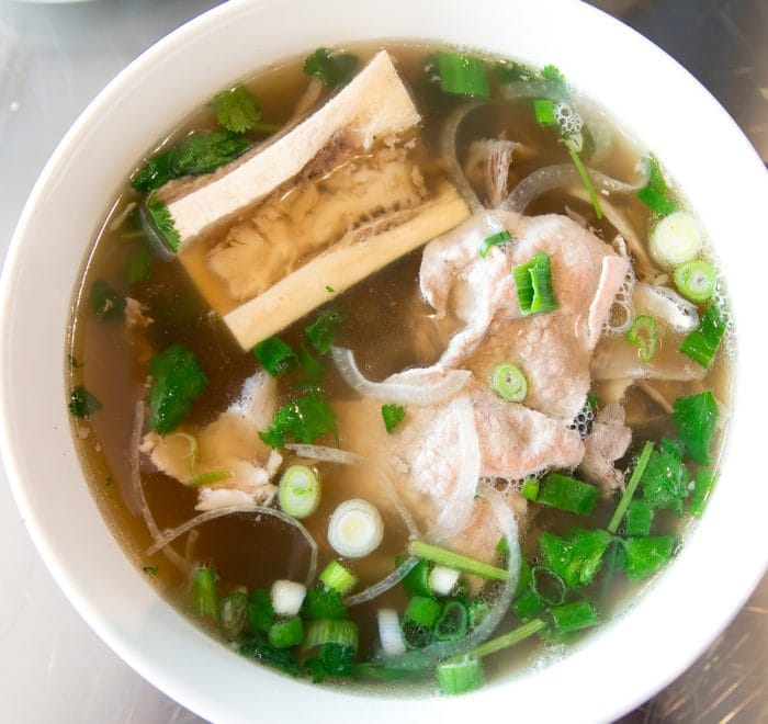 overhead photo of a bowl of Signature Pho S&B